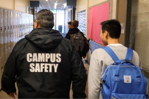 Image of campus safety officer with student