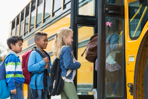 Image of kids getting on bus