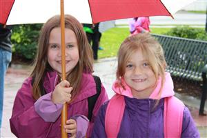 two children under an umbrella