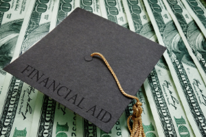 Image of graduation cap and money for financial aid